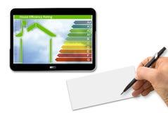 Bild för begrepp för byggnadsenergieffektivitet 3D framför av en digita Fotografering för Bildbyråer