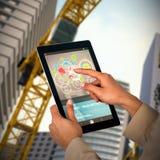 Bild för komposit 3d av affärskvinnan som använder den digitala minnestavlan Fotografering för Bildbyråer