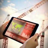 Bild för komposit 3d av affärsmannen som använder bärbara datorn och mobiltelefonen Arkivbilder