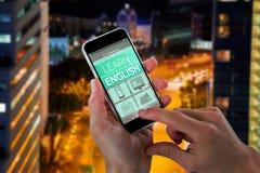 Bild för komposit 3d av närbilden av kantjusterade händer som rymmer mobiltelefonen Arkivbilder