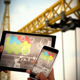 Bild för komposit 3d av slutet upp av händer genom att använda den digitala minnestavlan och mobiltelefonen Arkivbild