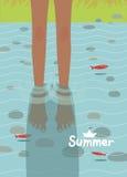 Bild mit Wasser, Fischen und bloßen Füßen Stockbild