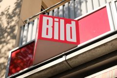 Bild signage on building exterior. Mannheim, Germany - August 23, 2017: Bild sign outside a newsstand. The Bild newspaper or Bild-Zeitung is a German tabloid stock images
