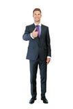 Bild in voller Länge eines jungen Geschäftsmannes, der sich Daumen zeigt und Stockbild