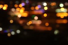 Bild von bunten unscharfen defocused bokeh Lichtern Bewegungs- und Nachtlebenkonzept Lizenzfreie Stockfotos