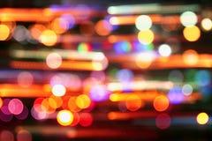 Bild von bunten unscharfen defocused bokeh Lichtern Bewegungs- und Nachtlebenkonzept stockbilder