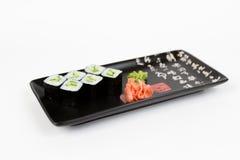 Bild von den geschmackvollen Sushi eingestellt mit Gurke Lizenzfreie Stockfotos