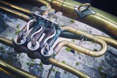 Bilden av ett fragment av ett tappningmusikinstrument Arkivfoton