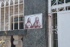 Bilden på ingången till huset av Jesus Christ och modern av guden philippines manila Royaltyfria Foton