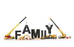 Bilden Sie eine Familie: Maschinen, die Familiewort aufbauen. Lizenzfreie Stockfotografie