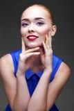 Bilden Sie Schöne blonde Frau Stockfoto