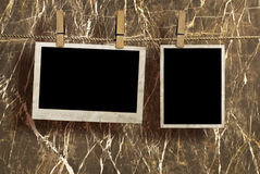 Bilder auf einem Seil mit Wäscheklammern Lizenzfreies Stockbild