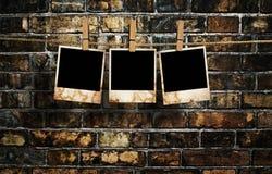 Bilder auf einem Seil mit Wäscheklammern Lizenzfreie Stockbilder