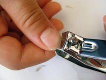 Bilder der Nagelreinigung und des Nagelausschnitts Lizenzfreies Stockfoto