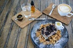 Bilder des Kaffees und des Kuchens Stockfotos