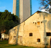 Bildings. Ancient Templers House in centre of Tel Aviv with the huge modern Tower on the background Royalty Free Stock Photography
