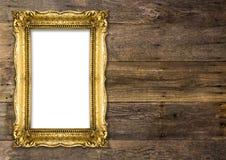 Bildram för gammal guld på träbakgrund Royaltyfria Bilder