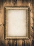 Bildram på träbakgrund Arkivbild