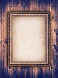 Bildram på träbakgrund Arkivfoto