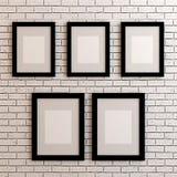 Bildramar på den vita väggen Arkivfoton