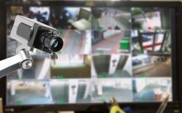 Bildskärm för CCTV-säkerhetskamera i regeringsställning som bygger arkivbild