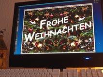Bildskärm - ljus lek - Frohe Weihnachten Royaltyfri Bild