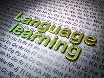 Bildungskonzept:  Erlernen der Sprache auf Alphabethintergrund Lizenzfreies Stockbild