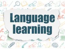 Bildungskonzept: Erlernen der Sprache auf heftigem Papier Lizenzfreies Stockbild