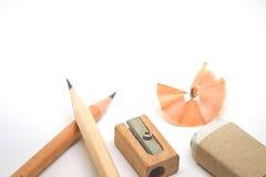 Bildungswerkzeug, Bleistift, Schrott-Radiergummi und Bleistiftspitzer Lizenzfreies Stockbild