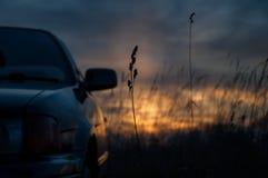 Bilfältsolnedgång Arkivbilder