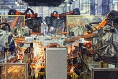 bilfabriksrobotar Arkivbild