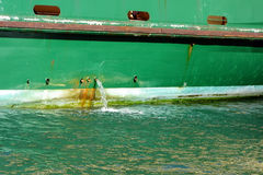 Bilge Water Pumped From Ship Foto de archivo
