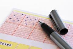 Bilhete de lotaria tiquetaqueado com lápis Imagens de Stock Royalty Free