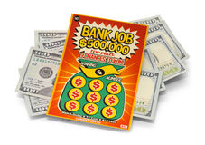 Bilhete de loto do risco e pilha do dinheiro Fotos de Stock