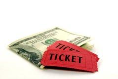 Bilhetes vermelhos para a admissão com dinheiro Foto de Stock Royalty Free