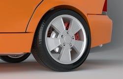 Bilhjul på grå studiobakgrund Arkivfoto