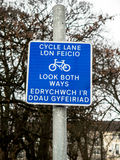 Bilingual cycle path sign Royalty Free Stock Image