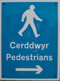 Bilingual pedestrian sign. Royalty Free Stock Photos