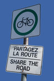 Bilingual share the road sign Stock Photos
