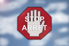 Bilingual Stop sign on blurred cloud background stock images