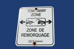 Bilingual tow away zone sign Stock Images