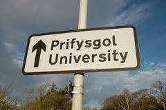 Bilingual university sign. Stock Image