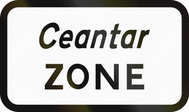 Bilingual Zone in Ireland. A bilingual Irish road sign - Zone, written in Gaelic and English Stock Photo