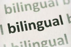 Bilingue de Word imprimé sur le macro de papier photos libres de droits