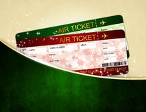 Biljetter för passerande för julflygbolaglogi i fack Royaltyfri Bild