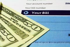 Bill-Anweisung und Geld-Nahaufnahme Stockbilder