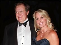 Bill Belichik and Linda Holliday. New England Patriots head football coach Bill Belichik and girlfriend Linda Holliday arrive on the red carpet outside the Time Royalty Free Stock Image