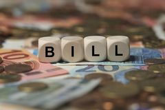 Bill - cube with letters, money sector terms - sign with wooden cubes Stock Photography