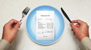 Bill on empty plate for visitor. The bill on empty plate for visitor at restaurant Royalty Free Stock Image