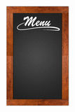 Bill of fare, menu card. Menu written on a blank blackboard with wooden frame isolated on white background Royalty Free Stock Photo